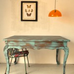 Mesa con patas de león vista frontal con adorno